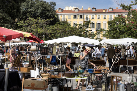 France, Provence Alpes Cote dAzur, Nice, Garibaldi Square: Street scene with people residents woman man at weekly flea market in the city center of the famous French town. August 19, 2017