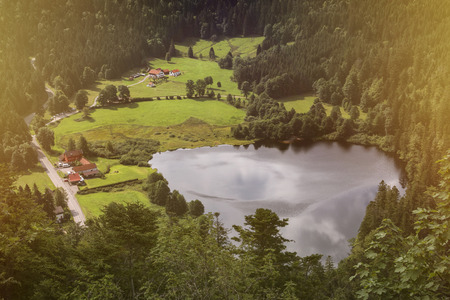France, near Retournemer: Small lake and settlement in the French woods - concept village birds eye perspective travel water nature environment tranquility settlement street rural landscape scenic Stock Photo