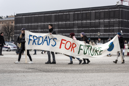 Austria, Vienna, Heldenplatz: Young people students men women at Fridays for Future demonstration in the city center of the Austrian capital - concept climate change global warming. February 01, 2019