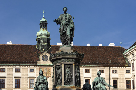 Austria, Vienna, Hofburg Palace, In der Burg: Famous emperor Francis statue and Austrian National Library facade at Josefsplatz in the city center of the capital with blue sky - concept Habsburg