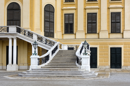 Austria, Vienna: Beautiful stairs as part of famous Schonbrunn Palace (Schloss Schoenbrunn) in the Austrian capital with dramatic blue sky - concept Habsburg architecture history culture tourism