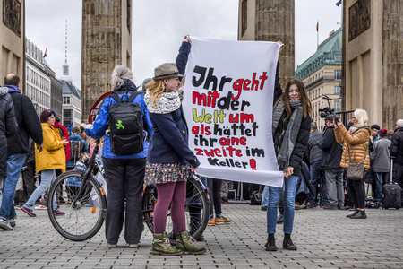 Germany, Berlin: Young girls pupils people women with 'You treat the earth as if you have a second one in the cellar' poster at Fridays for Future demonstration in the city center. Mar 29, 2019 Editorial