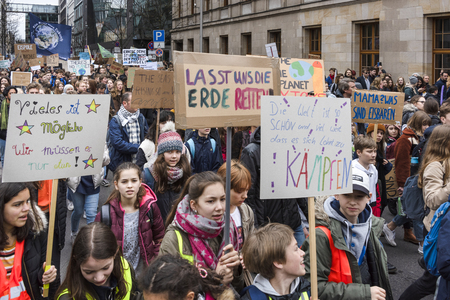Germany, Berlin: Young girls pupils people students women with 'Much is possible, we just have to do it' poster at Fridays for Future demonstration in the center of the German capital. Mar 29, 2019
