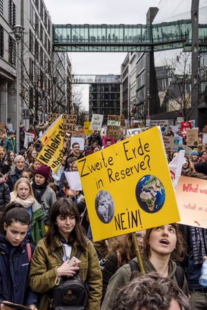 Germany, Berlin: Young pupils people students men women with 'Second earth in reserve? No!' poster at Fridays for Future demonstration in the city center of the German capital - crowded. Mar 29, 2019
