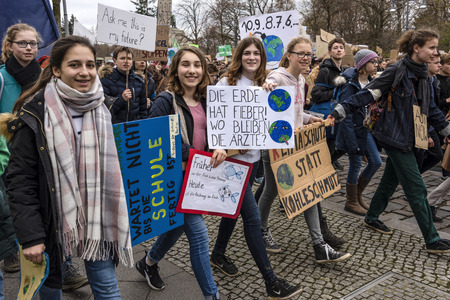 Germany, Berlin: Young pupils girls women with 'The earth has fever. Where are the doctors?' posters at Fridays for Future demonstration in the city center of the German capital. March 29, 2019