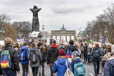 Germany, Berlin, Brandenburg Gate: Young pupils people students men women at Fridays for Future demonstration in the city center of the German capital - concept climate global warming. March 29, 2019