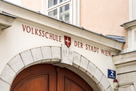 Austria, Vienna, Hietzing: Entrance gate front view of Adult Education Center (Volksschule) of the Austrian capital City of Vienna - concept education knowlede school learning. February 04, 2019