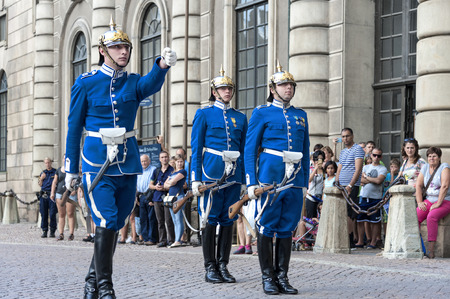 Sweden, Stockholm, Gamla Stan: People tourists residents watch Ceremony of change of guards with soldiers in blue uniforms in front of the famous King's Castle in the Swedish capital. August 08, 2014 Editorial