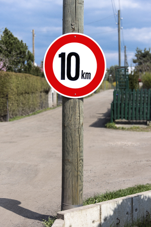 Germany: German traffic sign with speed limit 10 kilometers - concept traffic velocity speed rate limitation warning information rule law prohibition street road