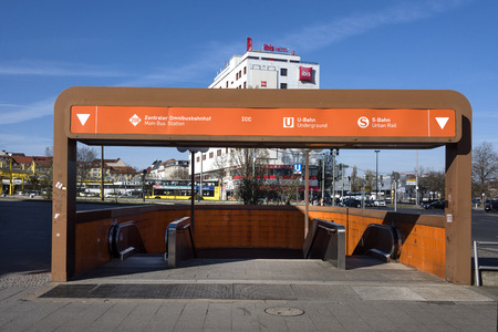 Germany, Berlin, Charlottenburg - March, 2017: Orange entrance of underground passage at the ICC Berlin with central bus station (ZOB) and hotel in the background.