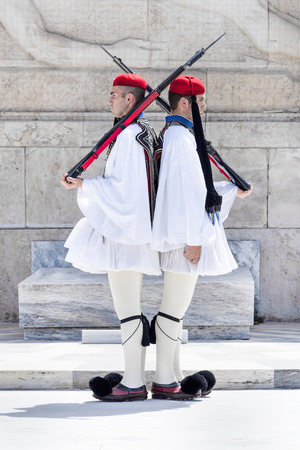 Greece, Athens: Two members of the Presidential Guard soldiers (Evzones or Evzonoi) in the city center of the Greek capital - concept history tradition ceremony elite military. May 01, 2018 Editorial