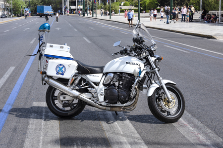 Greece, Athens, near Royal Palace: Street scene with white police motorbike in the city center streets of the Greek capital - concept traffic regulation control government uniform. April 29, 2018