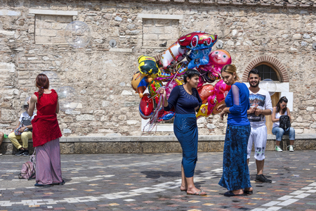 Greece, Athens, Monastiraki: Group of salesmen with colorful balloons for children kids in the city center of the Greek capital - concept toy fun happy leisure holiday business. April 29, 2018 Editorial