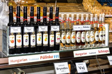 Hungary, Budapest, Great Market Hall: Different bottles of traditional fruit brandy Palinka offered at a stall in the famous Great Market Hall in the city center of the Hungarian capital. Feb 05, 2019