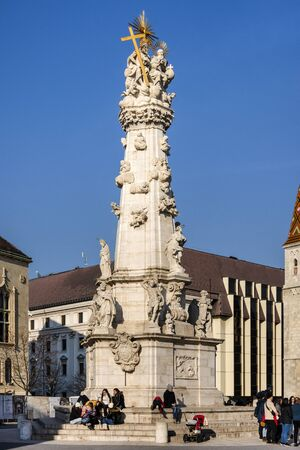 Hungary, Budapest, Castle Hill, Fischerbastei: People visit famous Matthias Church and Holy Trinity Statue near famous Fishermans Bastion above the city center of the Hungarian capital. Feb 06, 2019 에디토리얼