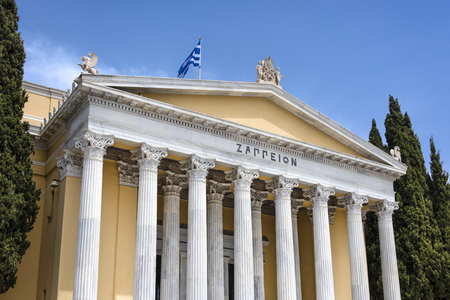 Greece, Athens: Front view of famous Zappeion building in the city center of the Greek capital and part of National Gardens with blue sky in the background - concept architecture travel history Stockfoto
