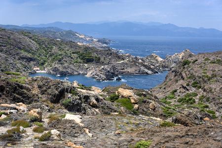 Spain, Catalonia, Cap de Creus: Panorama view of famous Spanish tourist destination with beautiful laguna, blue sea water, horizon  and cloudy sky - concept nature landscape cliff travel destination