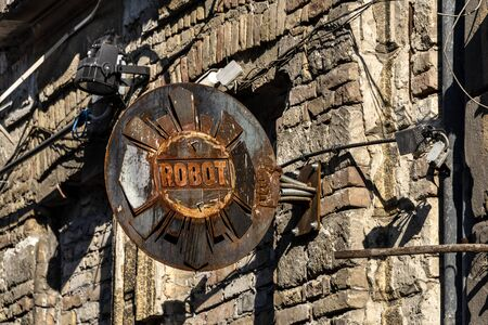 Hungary, Budapest, Akacfa: Detail close up of old rusty Robot sign on house facade of the famous popular ruin bar pub Fogas Haz (Toothy House) in the city center of the Hungarian capital. Feb 07, 2019