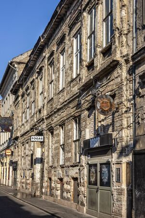 Hungary, Budapest, Akacfa: Street scene with run down front facade of famous popular ruin bar pub Fogas Haz (Toothy House) in the city center of the Hungarian capital - concept nightlife. Feb 07, 2019