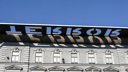 Hungary, Budapest, Andrassy Avenue: Big roof top sign on famous House of Terror museum in the city center of the Hungarian capital with blue sky in the background - concept memorial. Feb 07, 2019