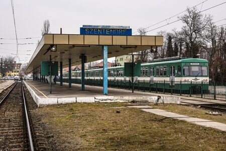 Hungary, Szentendre: Public terminal station with one train, platform, metals near the Hungarian capital Budapest - concept public transport railway traffic journey travel engine. Feb 08, 2019