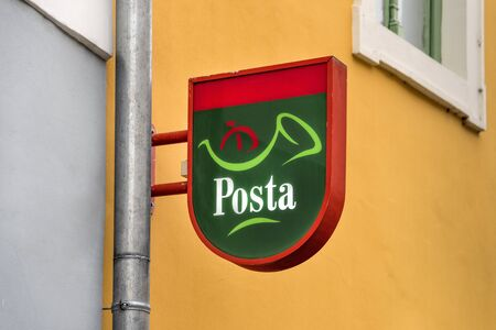 Hungary, near Budapest, Szentendre: Colorful brand logo emblem of Magyar Posta on exterior wall. The Hungary Post is a postal administration service - concept communication mail letter. Feb 08, 2019 에디토리얼