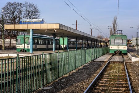 Hungary, Szentendre: Public terminal station with two trains, platform, metals near the Hungarian capital Budapest - concept public transport railway traffic journey travel engine. Feb 08, 2019