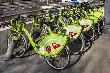 Hungary, Budapest: Street scene with row of green MOL hire bikes in the city center of Hungarian capital. MOL is a multinational oil and gas company - concept cycling transport rental. Feb 06, 2019