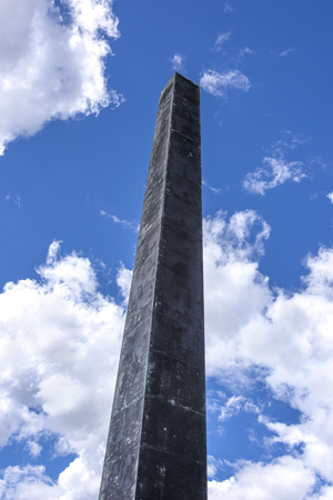 Germany, Bavaria, Munich, Karolinenplatz: Famous obelisk - total height 29 meter - from below in the city center of the Bavarian capital with cloudy blue sky in the background - concept history 写真素材