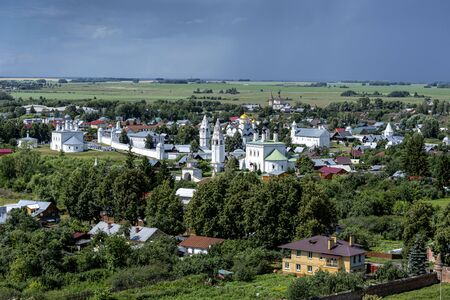 Russia, Vladimir Oblast, Golden Ring, Suzdal: Arial view of one of the oldest Russian towns with famous old Alexandrovsky Convent and river Kamenka seen from bell tower of Rizopolozhenskiy Monastery.
