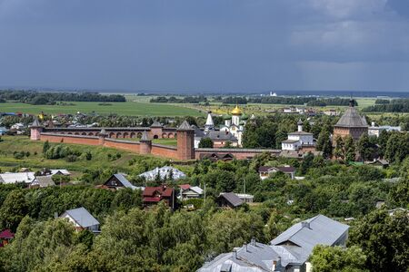 Russia, Vladimir Oblast, Golden Ring, Suzdal: Arial view of one of the oldest Russian towns with famous old Saviour Monastery of Saint Euthymius, Transfiguration Cathedral, donjon, river Kamenka.