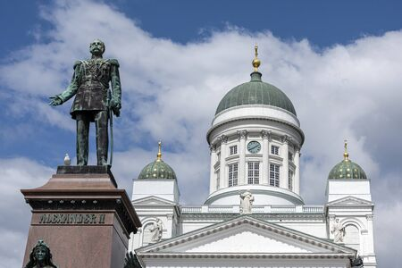 Republic of Finland, Helsinki, Senate Square: Panorama view of famous Alexander II statue and Helsinki Cathedral with big green dome, white facade, pillars in the city center of the Finnish capital. Archivio Fotografico