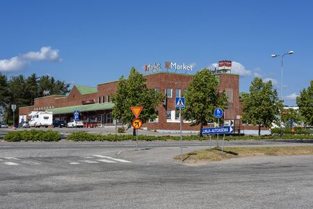 Finland, Rovaniemi: Street scene in the city center of the Finnish small town with modern shopping mall, parking lots, blue sky, public square - concept business daily needs supply. Jul 27, 2019 Redakční