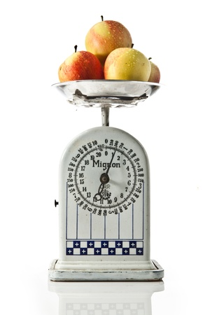 old scale with apples on white background Stock Photo