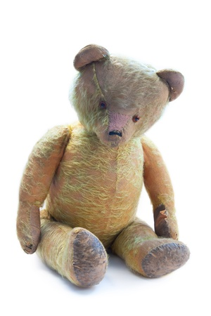 hundred years old teddy bear on white background