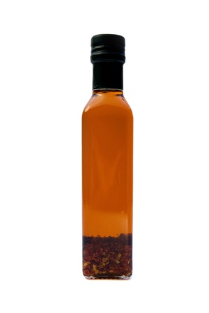 A bottle of olive oil with hot peppers