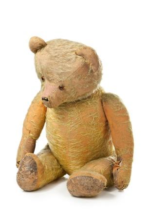 childchood: sad teddy bear on white background