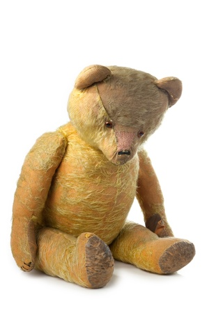 very old teddy bear on white background