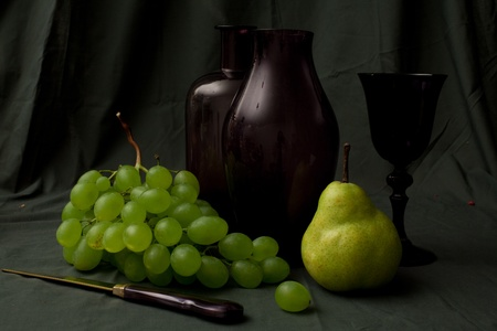 flemish: vintage still life with decanter, glass and grapes Stock Photo