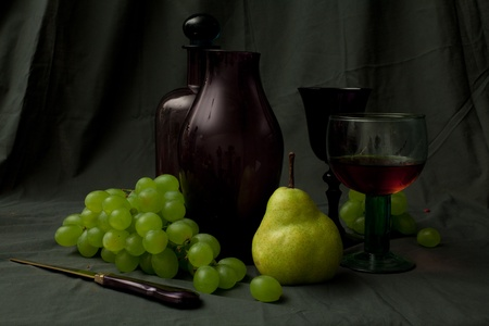 carafe, glass of vine and fruits