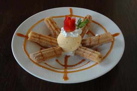 churros: Churros with Vanilla Ice Cream and Caramel Sauce Stock Photo