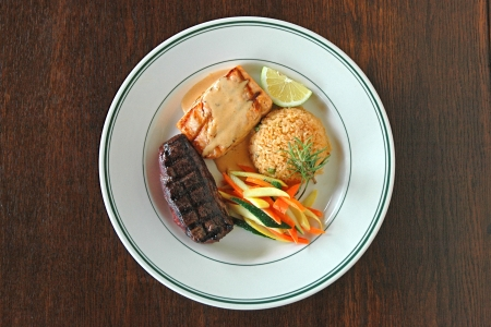 Grilled Steak and Salmon with Rice Pilaf and Steamed Vegetables photo