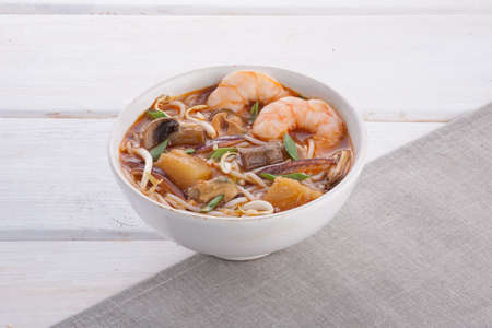 Oriental Asian soup with seafood and noodles