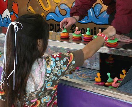 picking up ducks at the fair