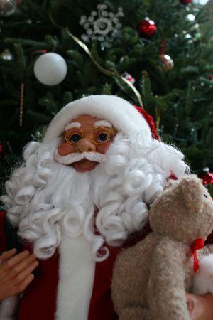 Santa by the tree