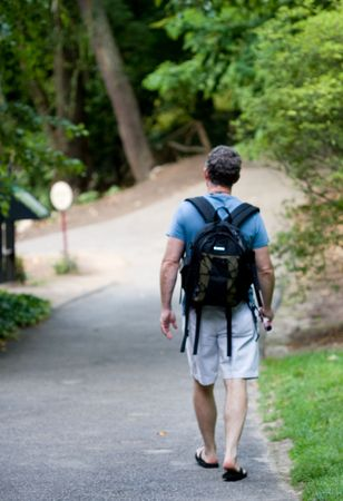 guy carrying camera bag
