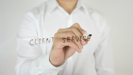 illustrating: Client Service, Written on Glass by Man in Studio Stock Photo