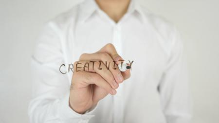illustrating: Creativity, Written on Glass by Man in Studio