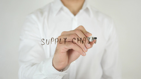 illustrating: Supply Chain, Written on Glass by Man in Studio Stock Photo