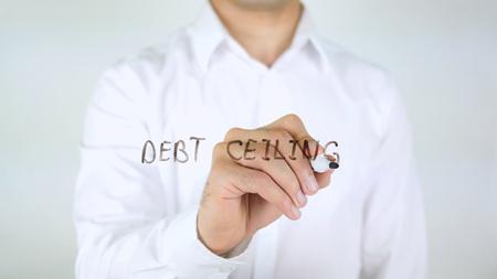 Debt Cieling, Man Writing on Glass